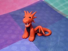 Handmade Polymer Clay Red and Black Mini Spike Head open mouth Dragon Figurine with Bead Eyes. $28.00, via Etsy.