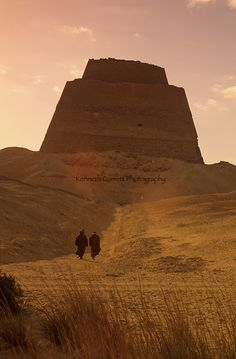 "Monuments of Ancient Egypt: the collapsed pyramid of Meidum (Maidum) attributed to Sneferu or Huni (Old Kingdom).  It is known as ""el-haram el-kaddab"" (the ""False Pyramid"") in Arabic because it now barely resembles a pyramid. It seems to have been designed as a seven step pyramid."