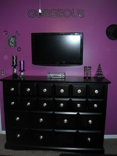 Black and Purple Bedroom - Love the paint color and the black dresser.