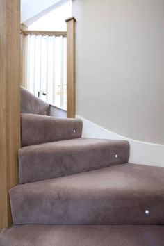 Carpet stairs with spot light : Stairs by A1 Lofts and Extension