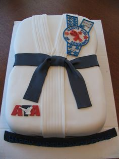 Karate birthday - Covered in fondant with gumpaste patches for the karate club.  This was a birthday cake for a 7 year old girl who is crazy about karate.  Only problem was that her mom had a hard time getting her to cut it!!  I was really happy with how this turned out.