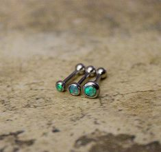 You will get SET OF 3 Barbells 2mm, 3mm, 4mm Green Fire Opal Triple Helix ring Please leave note for the size when making purchase otherwise 18g, 6mm bar will be sent which is standard for single helix piercing Available Bar Length : 6mm 8mm Available Gauge :18G, 16G Please Leave note