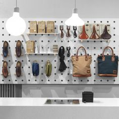 Menswear is displayed like tools in a shed at this shop in Stockholm by local designers. Haberdash by Form Us With Love #visual_merchandising #fashion_retail