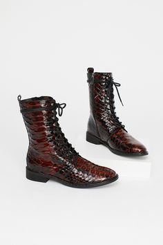Fort Night Lace Up Boot | Shiny textured leather combat-inspired boots featuring lace-up detailing. * Padded footbed * Metal stud detailing around the midsole * Stacked heel