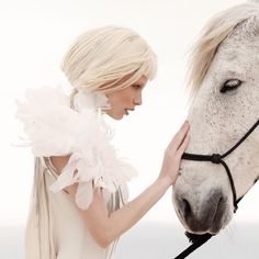 Loving a #horse means #trust in both ways! Unforgettable #equistylemagazine editorial. #white horse on the #beach #fashion #editorial