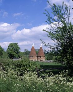 Pluckley,Kent, UK Typical Kentish scene, the Oast Houses were used to dry hops in the beer making industry, now most of them have been developed into living spaces. Pluckley and surrounding areas was the location for The Darling Buds of May, one of my favourite series ever
