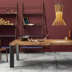 Sustainably sourced solid oak and  steel combine to create this rustic yet elegant industrial piece from Devina Nais.