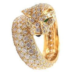 Cartier Panther Diamond Ring with Yellow Gold, Emerald and Onyx   From a unique collection of vintage cocktail rings at https://www.1stdibs.com/jewelry/rings/cocktail-rings/