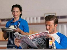 David Beckham reading the Sun