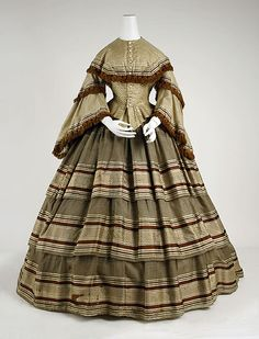 Striped brown silk dress with fringe trim, American, 1857-59.