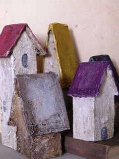 Paper houses by Gillian. I could do papier mache to make indoor bird houses to cover an entire wall with every colour in the land!