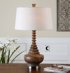 Uttermost Diega Solid Wood Table Lamp. Ribbed solid wood with an aged mahogany stain washed in a light tan glaze accented with brushed nickel plated details. The slightly tapered round hardback shade is an ivory linen fabric.