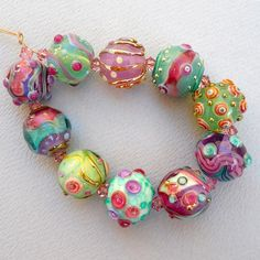 Lampwork Beads and Jewerly Handmade by Sara Hornik.  No information available.