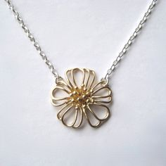 Brass Flower Necklace, Floral Necklace, Minimal Jewelry, Mixed Metal Jewelry. $28.00, via Etsy.