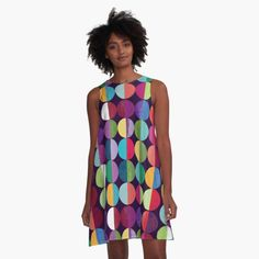 100% Polyester woven dress fabric with silky handfeel Print covers entire front and back panel Loose swing shape for an easy, flowy fit Sublimation transfer technique prints crisp, bold colours Garment fully constructed and printed in the USA