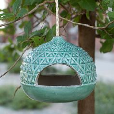 """Geometric details embellish this suspended feeder, made from glazed terracotta and paired with a length of rope for hanging among the branches.- Glazed terracotta, rope- Wipe clean with damp cloth- Indoor or outdoor use- Drainage hole included- Opening: 1.75""""H, 3.75""""W- 29"""" rope- Imported6""""H"""" 7"""" diameter"""