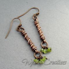 Lightweight, feminine and fun, The Gwendolen artisan earrings with peridot chips are the perfect for any outfit or occasion. These earrings are handcrafted from strands of cold-forged pure copper wire, and antiqued and buffed by hand to bring out the contours of the wire work. Three chips of lime green peridot gemstone dangle from the bottom of each earring for a festive, floral look. The Gwendolen earrings measure 5 cm (aproximately 2 inches) long from top to bottom.