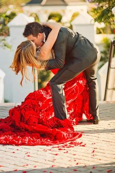 Get inspired: Fiery red wedding dress, anyone? It goes wonderfully well with the scattered red rose petals on the floor. Beautiful!