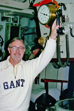 On the horn for more power from the engine room of the HMAS Vampire in Sydney Harbor in 1998.  Photography by David E. Nelson
