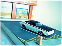 free paper dioramas free template OR download -  This 1:64 Mini-Mart Diorama papercraft is suitable for your diecast car on top of its parking lot. Templates designed by Maulana Jodi.