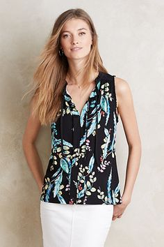 Ruffle at neck and around arm holes, ruffled front panel where it meets the shoulder seam, tie right under ruffle, front might not button - could be over-the-head. ~Ruffle-Trim Tank #anthropologie