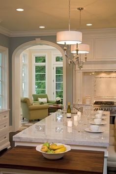 Kitchen & keeping room. Kitchen paint color and LOVE the arch as well as the marble countertops