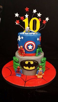 Avengers Lego cake. With Spider-Man and emmet. Has hulk hands, captain America shield, a batman tier, and ironman.