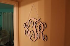 Monogram laser-cut into wood and painted.  For our baby room.