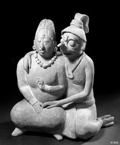 Jaina Couple:   Maya. Jaina. clay. Double figure of young height 18.5 cm. Woman with saurian in an amorous pose. See number 8579 for a Veracruz flute with the same theme.