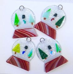 Listing is for one fused glass ornament with adorable snow couple. The ornament stands approximately 4 inches tall and 3 1/2 inches wide at the widest point. Each ornaments has a decorative ribbon and wire hanger.