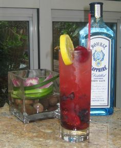 The American Collins  1 1/2 oz. Bombay Sapphire  3/4 oz. simple syrup  1/2 oz. fresh lemon juice  4 Bing cherries, pitted  8 blueberries