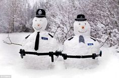 Just doing our bit: Snow and ice will melt more slowly if it is compacted into snowmen than if it is simply lying on the ground