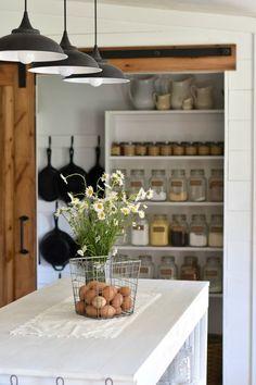 Beautiful open shelving pantry storage in farmhouse kitchen. Rockyhedgefarm.com
