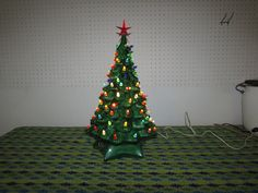 "VINTAGE 18"" Green Ceramic Christmas Tree with Colorful Twisted Lights and Musical Base. by VeiledThroughTime on Etsy"
