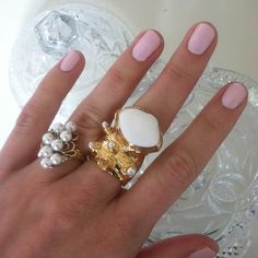 The best thing about this photo is the center ring it is vividly on trend and is teamed for summer with a tan and simple baby pink nail polish Jewelry Box, Jewelery, Jewelry Accessories, Baby Pink Nails, Big Rings, Dainty Ring, Nails Inspiration, Vintage Rings, Girly Things