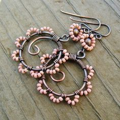 Bead Dance earrings in Cheyenne Pink - wire wrapped antiqued copper hoops with seed beaded petals