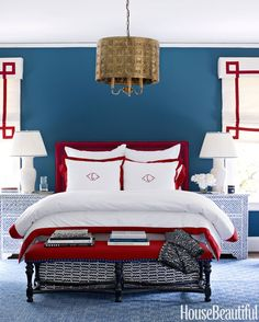 Red, white and blue bedroom by designer Lindsey Coral Harper. Greek Key pendant light from C. Bell. Walls are painted Benjamin Moore's Van Deusen Blue. Vintage nightstands are from Liza Sherman; Julia B. bedding. | House Beautiful