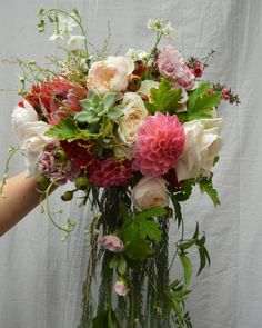 Bouquet with protea, rose, scented geranium and dahlia