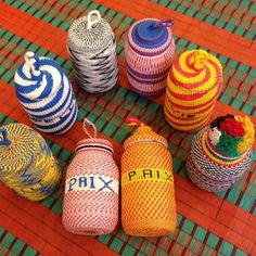These jars are handmade by prisoners in Sénégal. The money they make when they sell them is helping them to live, and to prepare their reintegration when they leave the jail. They made some special designs and writings for CSAO: