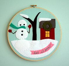 Felt Winter Scene tutorial by Melissa Crowe from Checkout Girl for Bugs and Fishes. This decoration includes hand applique patterns for all the figures.