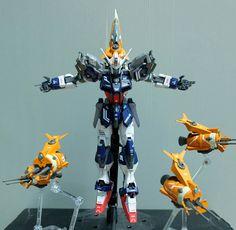 MODELER: Tan [Inoshishi Daikyodai]  MODEL TITLE: Variant Strike Gundam  MODIFICATION TYPE: custom color scheme, add-on, custom details  KITS...