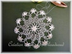 Beautiful example of Mary Konior's pattern combined with a Cluny petals. Spectacular.
