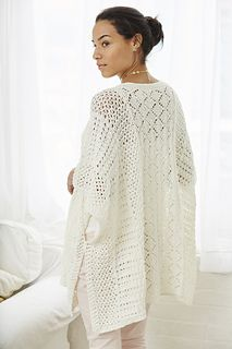 Three allover lace designs combine in Drysdale's deceptively simple sideways-knit poncho. Two simple four-row lace patterns at the sides and a center diamond lace panel are knit in one piece from side to side with a neck opening. Seaming is a cinch: Edges are tacked together with openings left for the armholes and side slits. A band of garter stitch surrounds a neckline open enough to show a hint of collarbone. Knit it in the linen sheen of Ariana by Stacy Charles Fine Yarns.