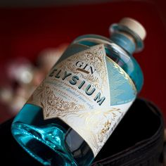 Naming and design for Elysium Gin. A baroque concept for the premium spirits manufacturer The Poshmakers. The design of this bottle is based on the victorian era with a pharmacy inspiration.   — #gin #londongin #spirits #cocktail #drink #mixology #theposhmakers #packagingdesign #graphicdesign #identity #naming #winemarketingguru #valentiniglesiasiturralde #branding #design #creativity #experimental Tequila, Vodka, Virgin Gorda, Wall Mounted Desk, Marketing Guru, London Dry Gin, Packaging Design, Branding Design, Ron