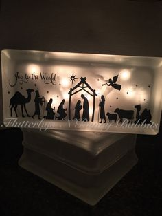 This listing is for one lighted, frosted, glass black with a nativity scene. This makes a gorgeous addition to your Christmas decor. Lights are included. Block measures 4x8 Shipping policies- If you need your item before the processing time then please message me first to make
