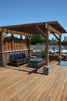 Tropical Hardwood Deck, Cedar Pergola with Slat Screening, Stone Accents, Firepit, Skylight, Built-in Planter, Lighting, Sofa, Lounge Chair, Side Table