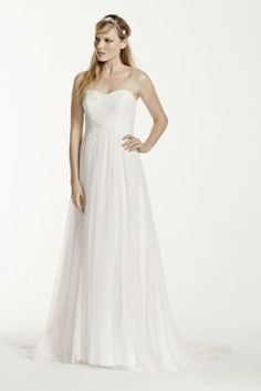 """Magnificent is an understatement for this ruched tulle wedding dress. Long and soft, this delicate gown is simply gorgeous.   4"""" extra length gown.  Strapless bodice and empire waist elongate the figure providing a slimming effect.  Criss-cross ruching on bodice provides a slimming focal point.  Sweep train. Sizes 0-14.  Available for special order only in store and online in White or Soft White.  Fully lined. Back zip. Imported polyester. Dry clean only.  Missy: Style WG3438. Sizes 0-14."""