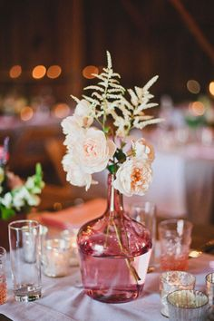 Oh, it might be cute to do different vases at each table! Keep the color scheme similar but play with the shapes and style - I really like this idea!