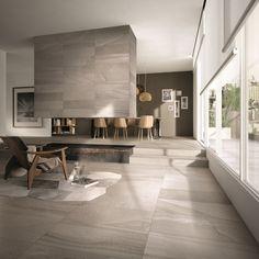 #Living realizzato con RE-WORK Multi Fog di ABK. Le caratteristiche grafiche di diverse pietre sono state ri-elaborate in chiave contemporanea e mescolate sapientemente per vestire #pavimenti e #pareti. #abkemozioni #ceramics #tiles #gres #porcellanato #homedesign #stones