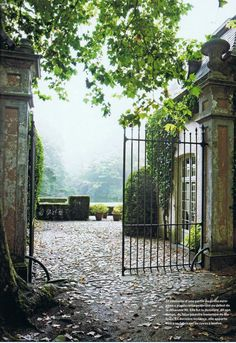 Romantic garden Gate Ideas and Beautiful Gardens to Inspire! Iron gates at a French chateau open to lush gardens in the mist.